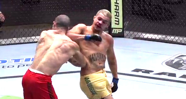 Tyler Manawaroa (right) lands a spinning back elbow on the chin of Nordine Taleb.
