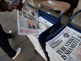 An underground strike story features on the front page of a newspaper