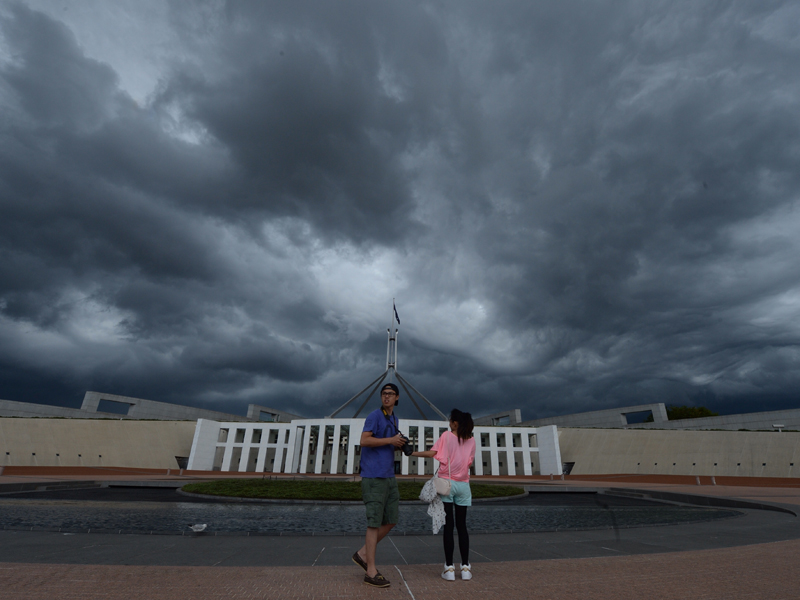 Storm clouds are seen building up over Parliament House