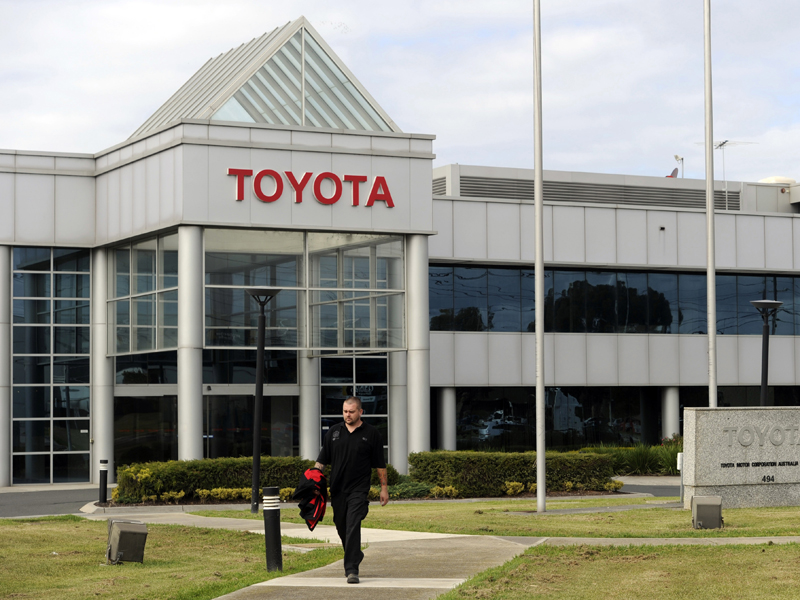 Workers arrive at the Toyota Plant in Melbourne