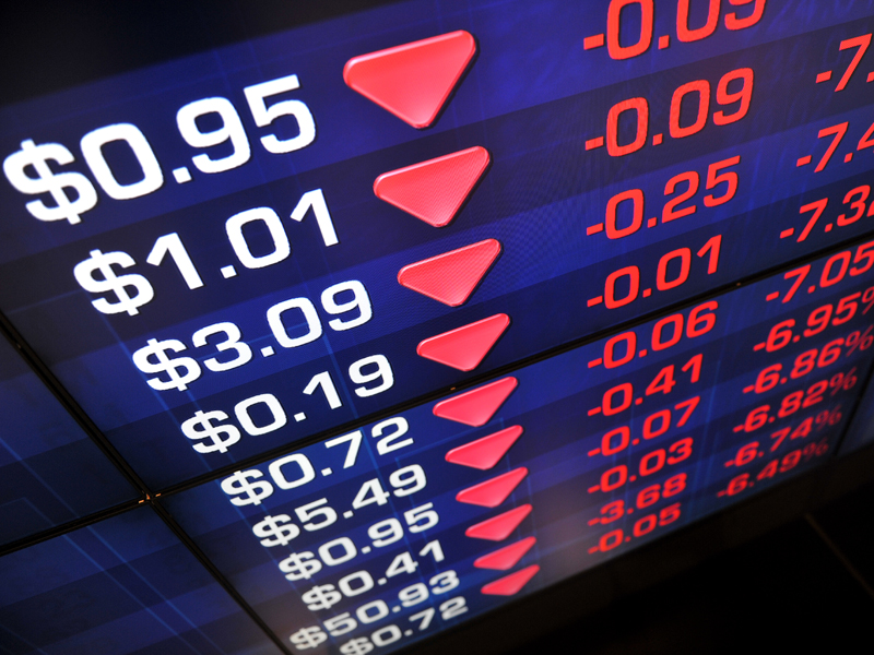 A screen displays stock market prices in Sydney