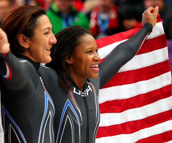 US bobsleigh contestant Lauryn Williams (right) celebrating her silver medal win with team mate Elana Meyers.