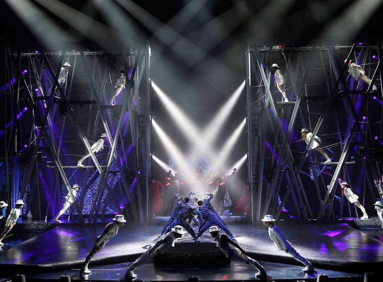 """Performers on stage during a performance of Cirque de Soleil's """"Michael Jackson ONE"""" show."""