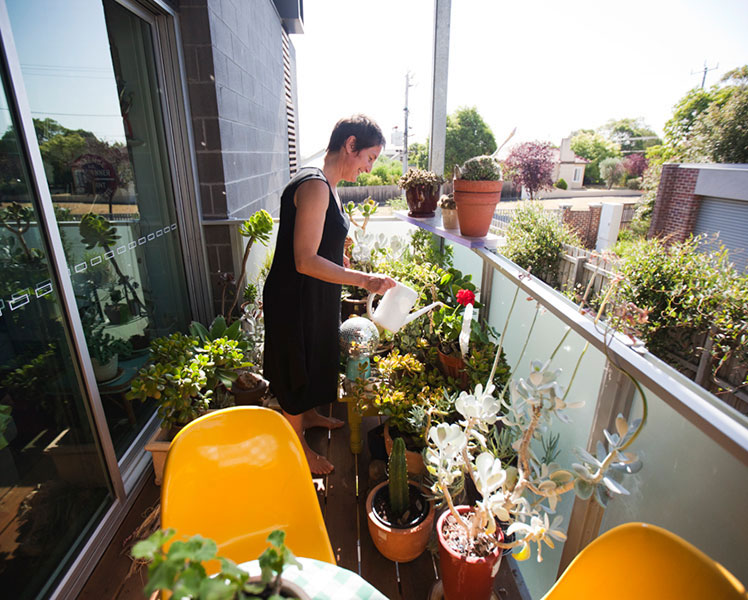 Gardening on the balcony. Source: Chris Grose