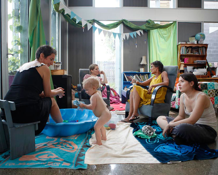 Residents of all ages relax in a communal area at Murundaka. Source: Chris Grose.