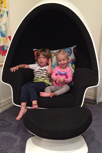 Zac and Lola relax in a replica Eero Aarnio ball chair.