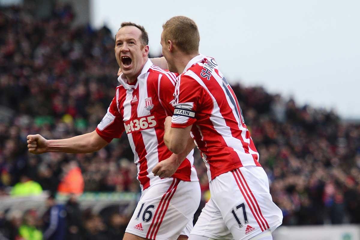 Charlie Adam and Ryan Shawcross of Stoke City celebrate the opening goal.