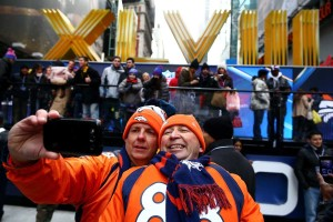 Fans Todd Barnes (left) and Mitch Daniels in Times Square.