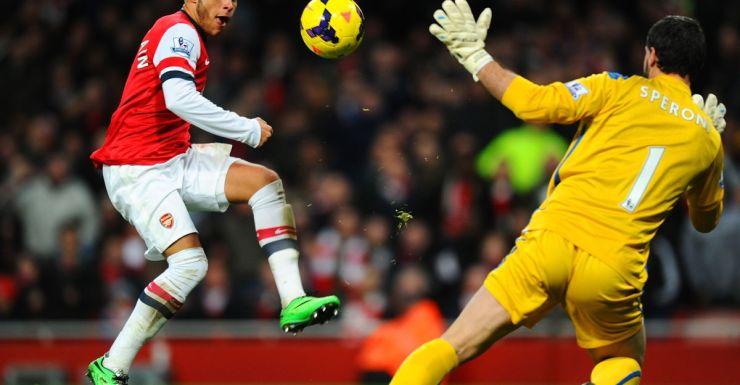 Alex Oxlade-Chamberlain negotiates Julian Speroni to score his first goal.