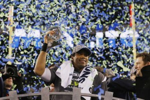 Seahawks quarterback Russell Wilson with the spoils of victory.