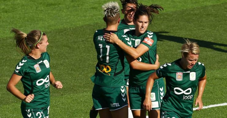 The Canberra United players celebrate a goal.