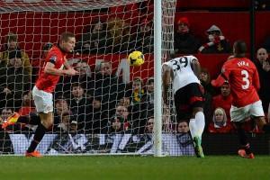 Fulham's English striker Darren Bent scores the equaliser.