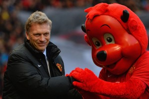 Manager David Moyes seeks solace from the club mascot.