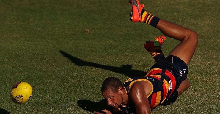 Cam Ellis-Yolmen of the Crows shows his flexibility.