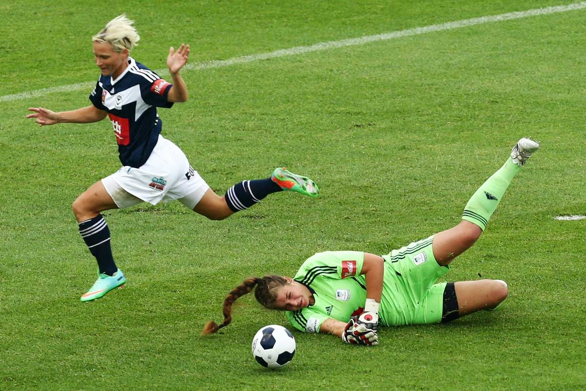 Jessica Fishlock of the Victory competes with Sydney goalkeeper Casey Dumont.