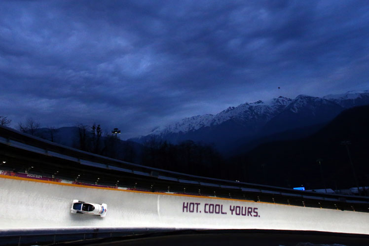 The Russian two man bobsleigh team cuts through the Sochi night. Picture: Getty