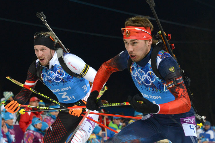 Anton Shipulin (right), the hero of Russia's biathlon relay win, fights it out with Austria's Dominik Landertinger. Picture: Getty