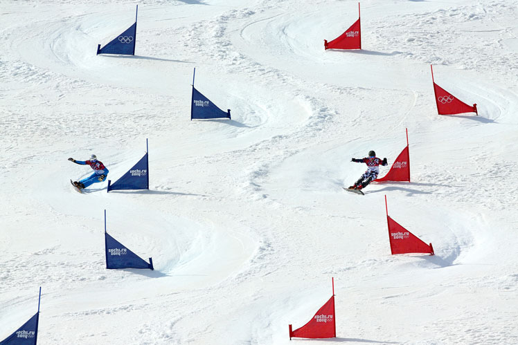 Vic Wild of Russia (right) competes with Austria's Benjamin Karl in the snowboard parallel slalom. Picture: Getty