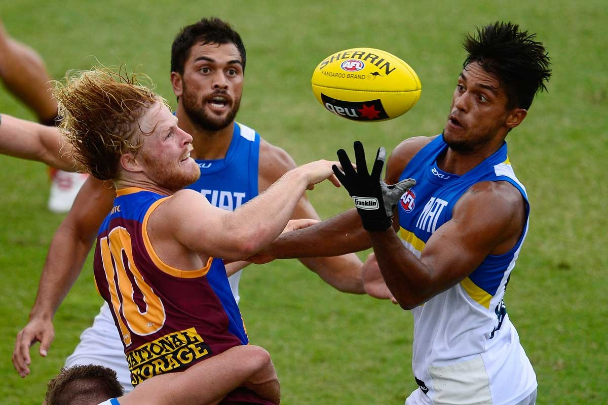 Brisbane's Daniel Rich contests the ball with the Suns' Aaron Hall.