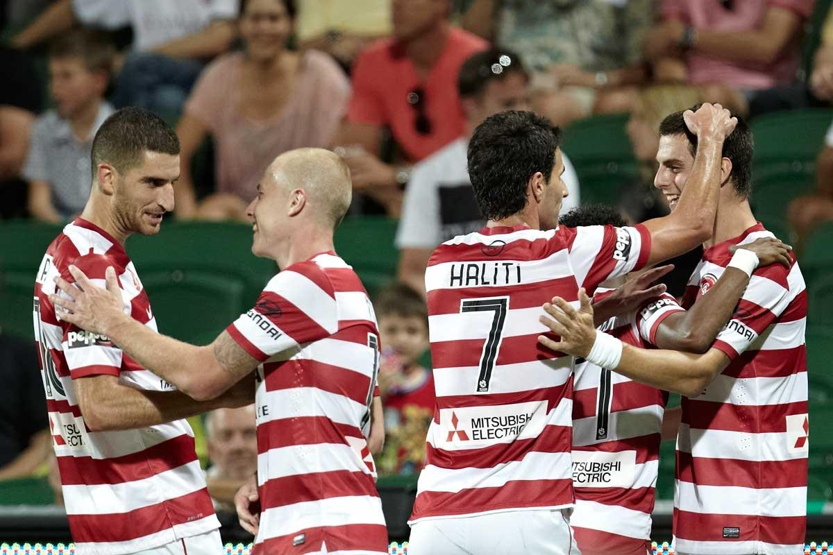 Western Sydney players celebrate their win.