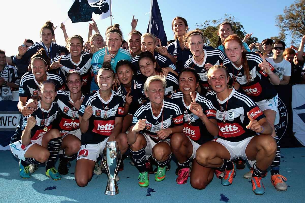 Winners are grinners: The victorious Melbourne Victory team.