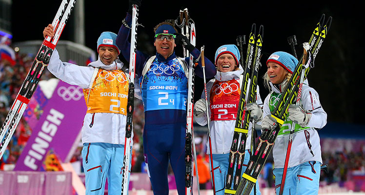 The Norweigan team of Ole Einar Bjoerndalen, Emil Hegle Svendsen, Tora Berger and Tiril Eckhoff  celebrate winning gold in the 2x6km Women + 2x7km Men Mixed Relay. Photo: Getty