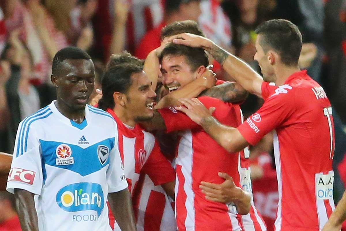 Harry Kewell is congratulated after scoring.