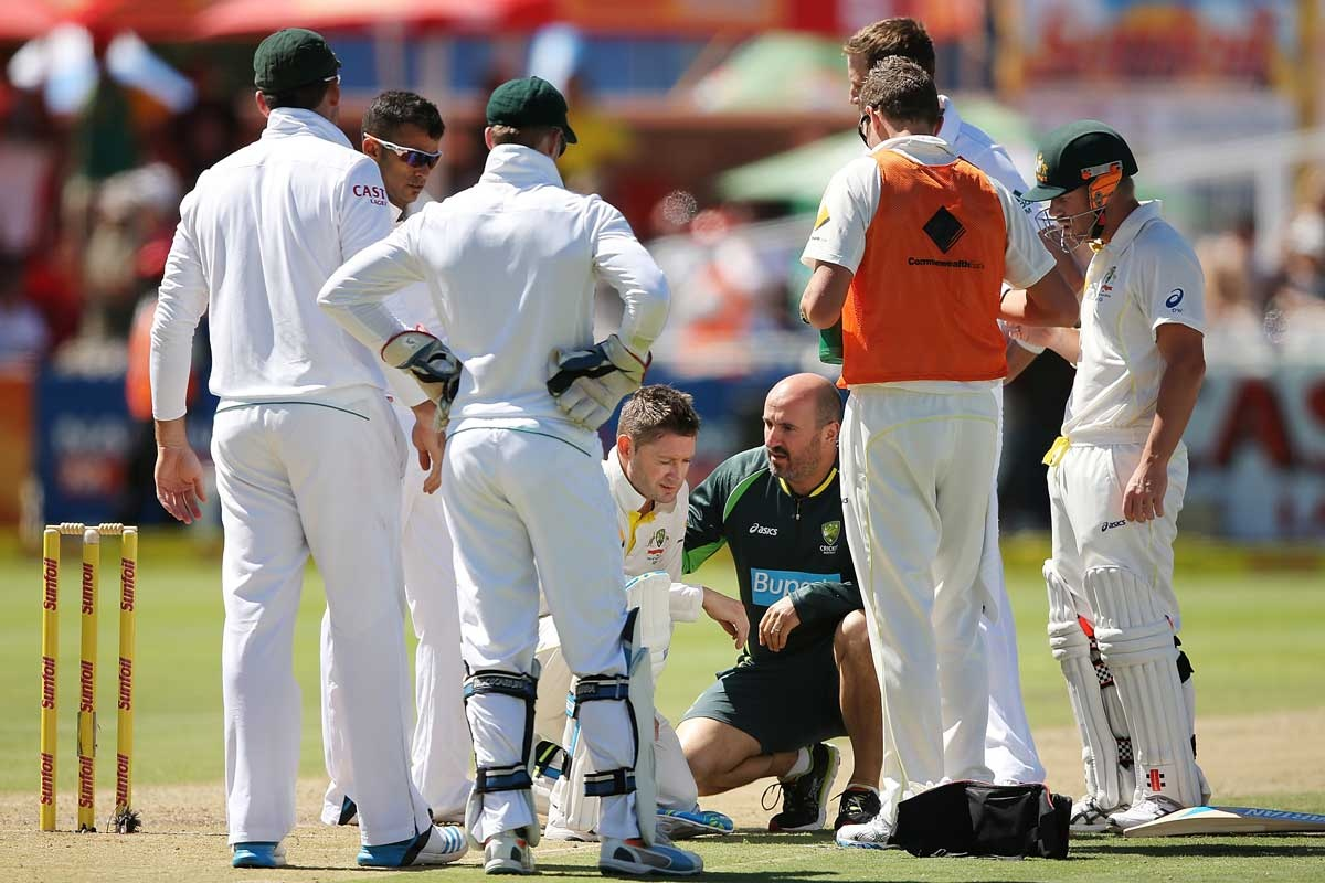 Clarke receives help after another blow from Morkel.