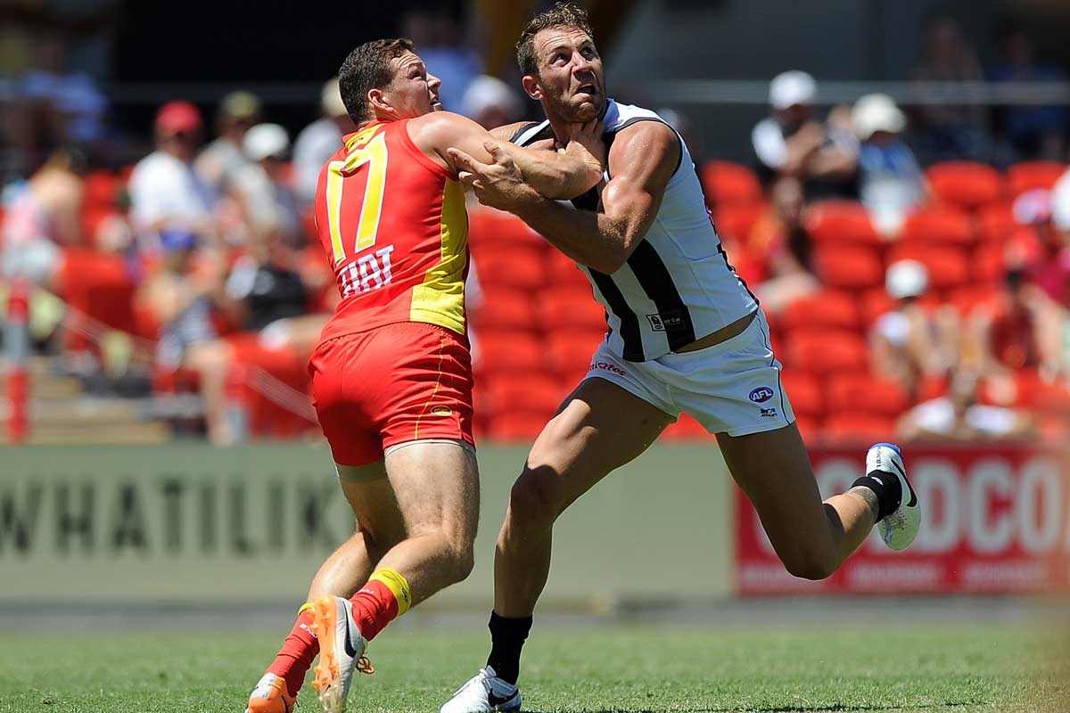 Travis Cloke (right) and Steven May flex their muscles.
