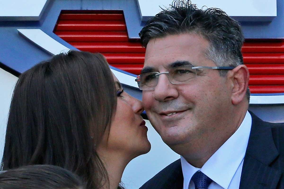 Andrew Demetriou gets a kiss from wife Symone.