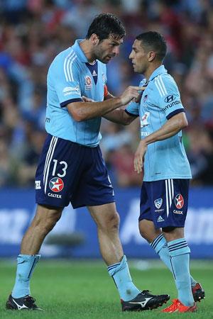Teammate Sasa Ognenovski tries to reassure Abbas. Picture: Getty