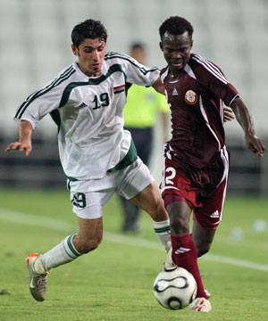 Playing for Iraq against Qatar during Olympic qualification in 2007. Picture: Getty