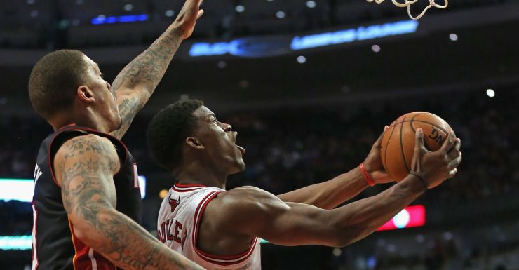 Jimmy Butler of Chicago puts up a reverse layup.