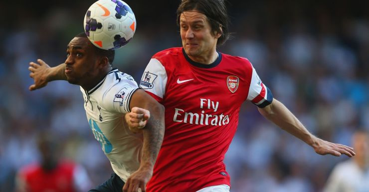 Arsenal's scorer Tomas Rosicky (right) competes with Danny Rose.