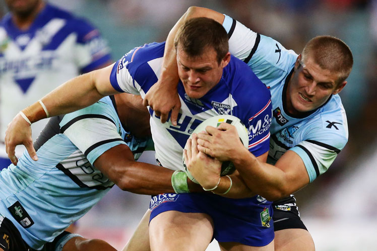 Josh Morris of the Bulldogs barges through the Cronulla defence. Picture: Getty