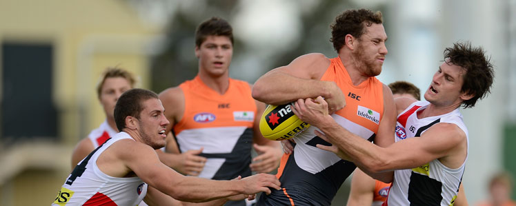 Shane Mumford displays his finesse and subtlely in GWS colours. Picture: Getty