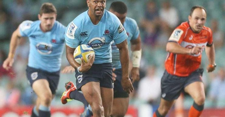 Kurtley Beale makes another break for the Waratahs.