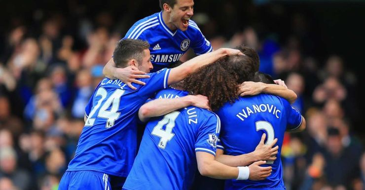 Eden Hazard of Chelsea is mobbed after scoring their fourth goal.