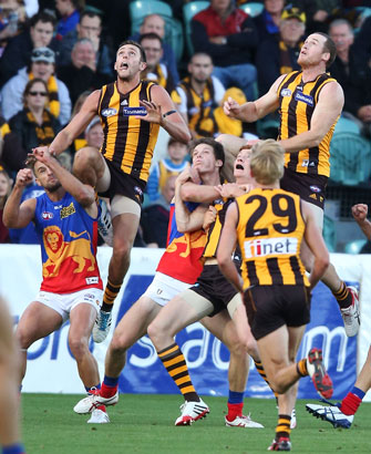 Eyes on the prize: Jack Gunston (left) and Jarryd Roughead fly. Picture: Getty