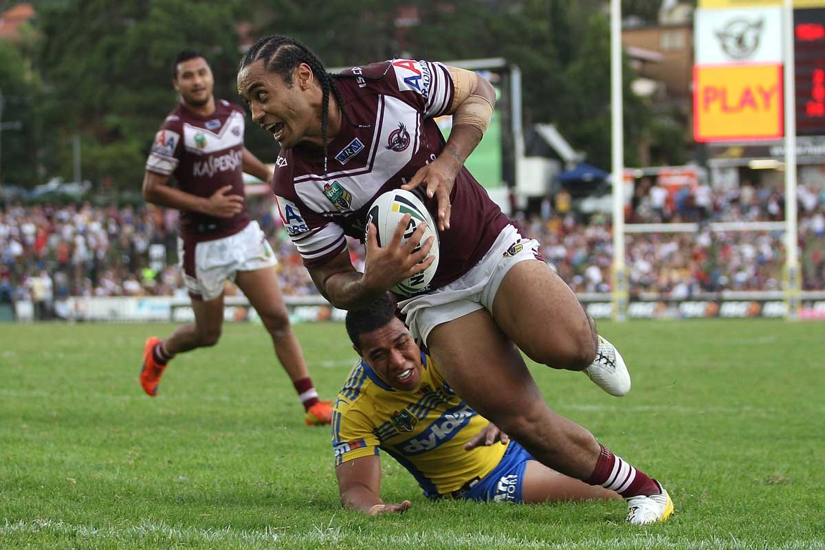 Steve Matai of the Sea Eagles scores the match winning try.