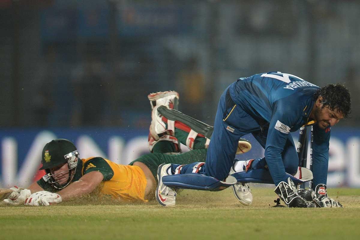Sri Lanka's Kumar Sangakkara runs out David Miller of South Africa.