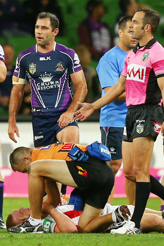 Alex McKinnon is treated after landing on his head. Picture: Getty