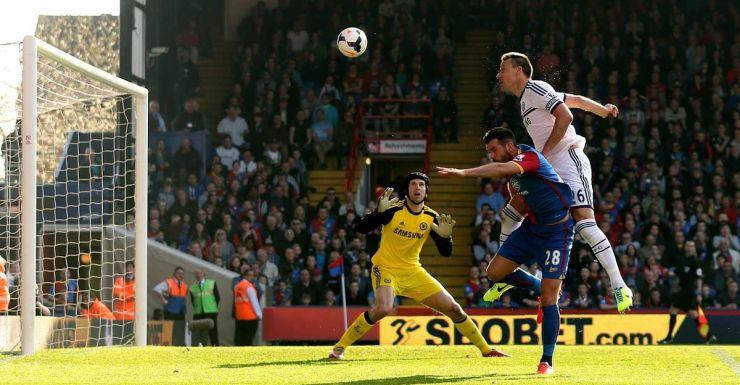 John Terry heads a cross into his own goal.