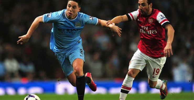 Samir Nasri of Manchester City (left) competes with Arsenal's Santi Cazorla.