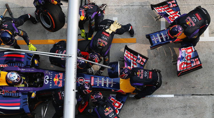The Red Bull team makes running repairs to the nose of Daniel Ricciardo's car. Photo: Getty