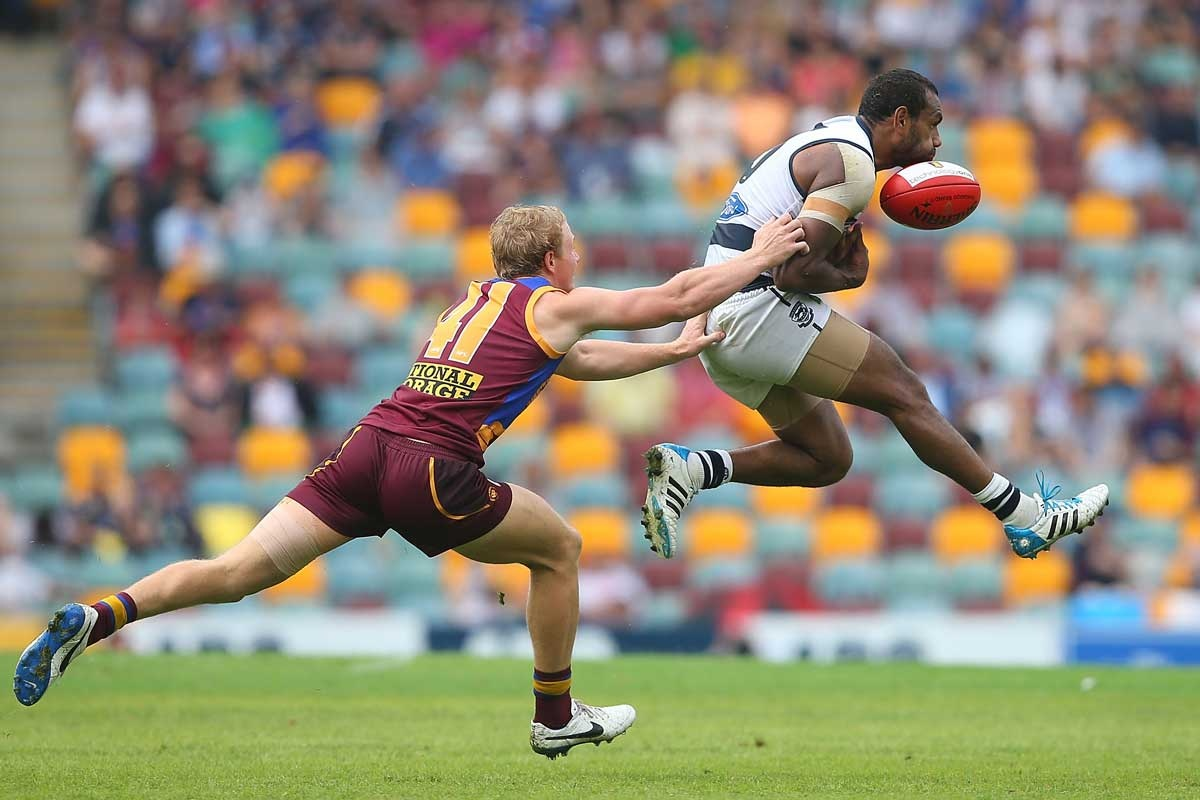 Geelong's Travis Varcoe tries to snare a chest mark.