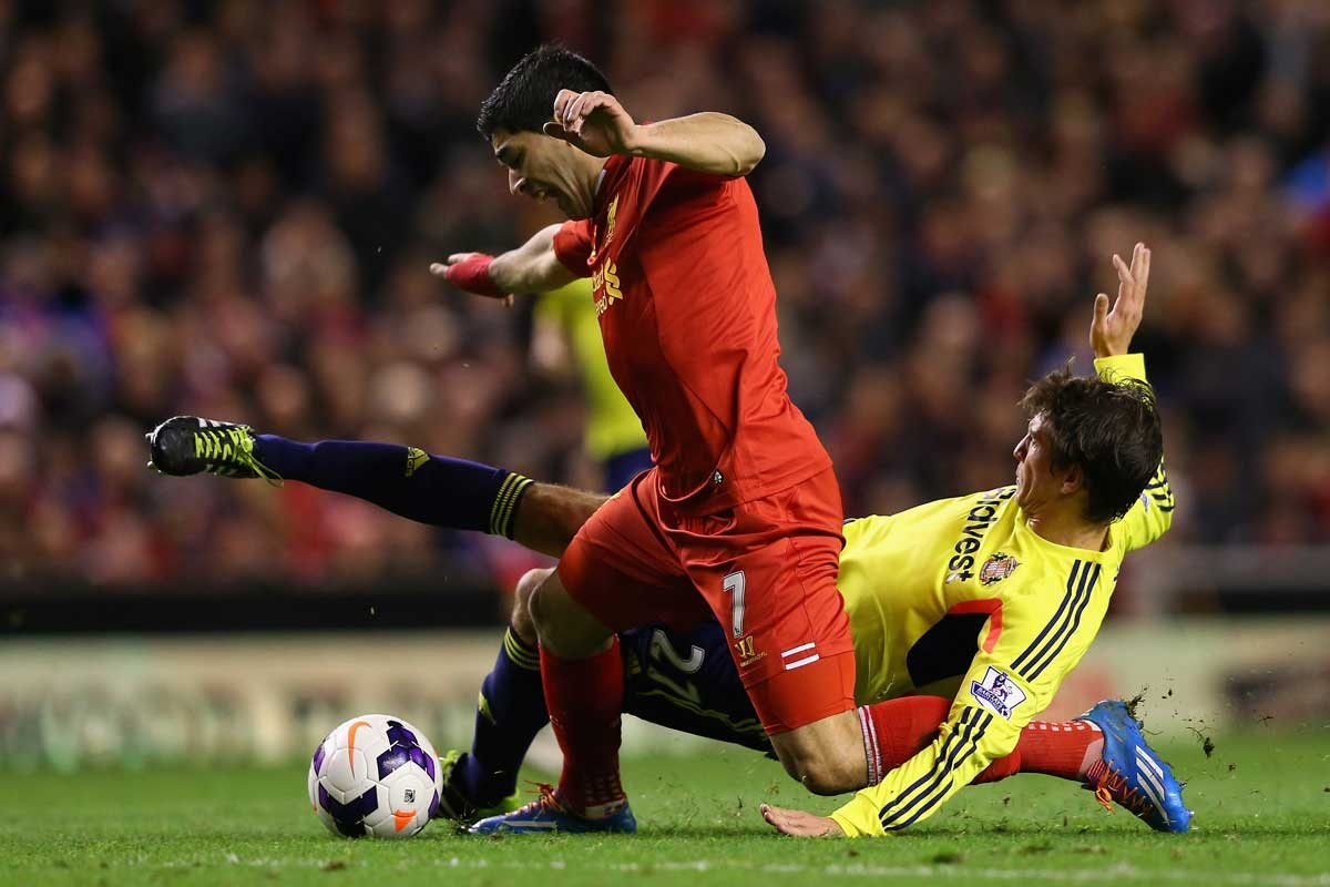 Santiago Vergini fouls Liverpool's Luis Suarez to concede a free-kick and goal.