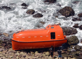 An Australian life-boat washed up on an Indonesian beach.