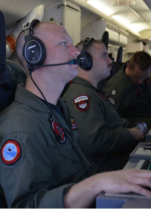 US serviceman on the P-8A Poseidon which is part of the search effort.