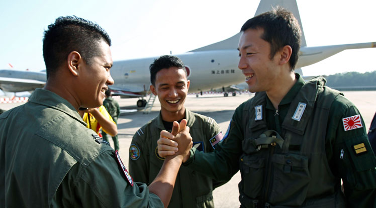 A Japanese Self-Defense Force member is wished well by a Royal Malaysian Air Force serviceman.